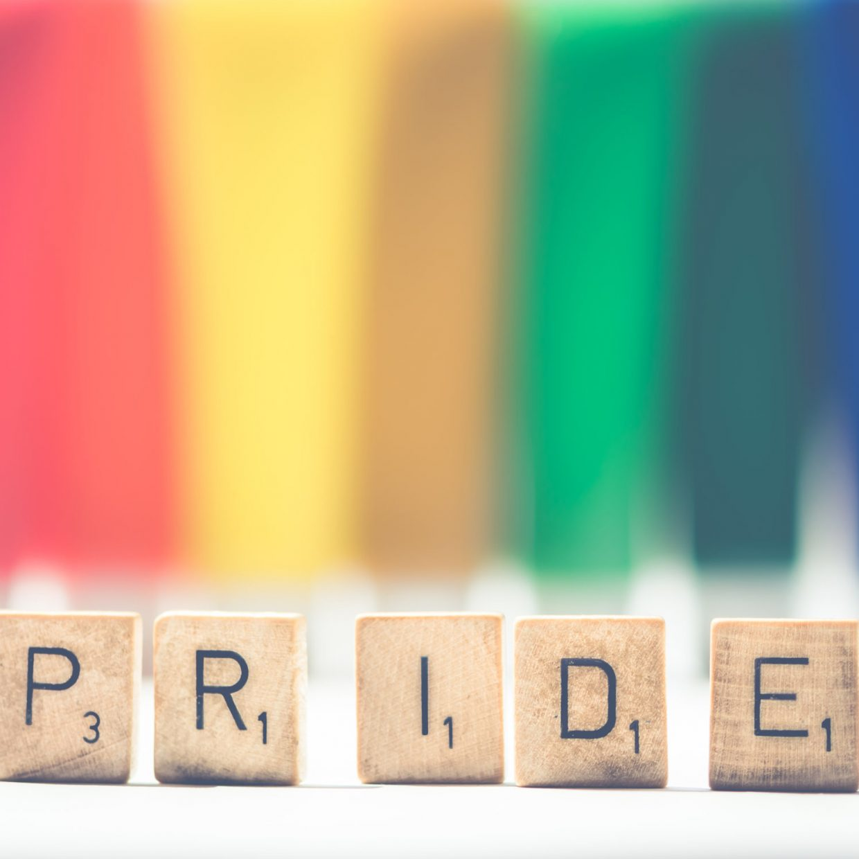 Canva-Selective-Focus-Photography-of-Scrabble-Pride-on-White-and-Multicolored-Background-scaled-e1574279091734